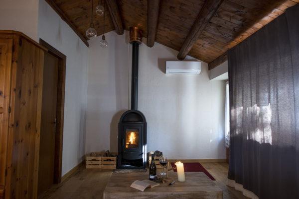 Villaggio-Nativo-camere-capanna-stufa
